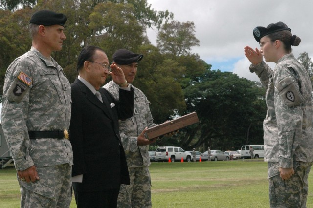 Hawaii Senator Daniel K. Inouye salutes Capt. Terry H. Zoch, commander, Echo Company, 2nd Squadron, 6th Cavalry Regiment, 25th Infantry Division (pictured right), after receiving the Medal of Honor flag at a ceremony held at Schofield Barracks' Sills Field, Aug. 20. Accompanying Inouye is Maj. Gen. Robert L. Caslen Jr., commanding general, 25th Inf. Div., and Command Sgt. Maj. Frank M. Leota, command sergeant major, 25th Inf. Div.
