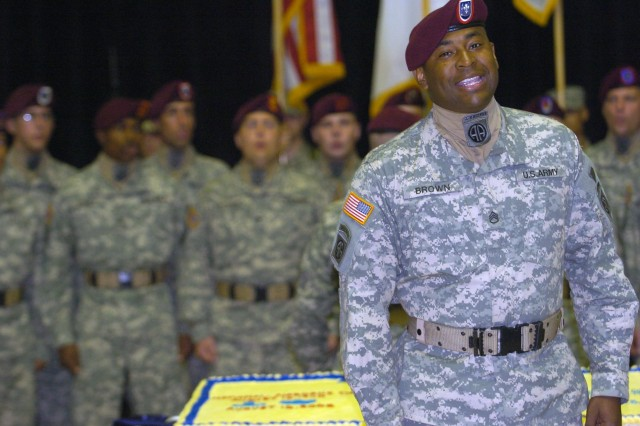 Sgt. Carey Brown, a member of the 82nd Airborne Division's All-American Chorus, sings 'Carolina on my Mind' in tribute to the home of the XVIII Airborne Corps.  The Chorus took part in a ceremony Aug. 22 at the Al Faw Palace, Camp Victory, Baghdad, honoring the first parachute jump and the XVIII Airborne Corps' 64th birthday.