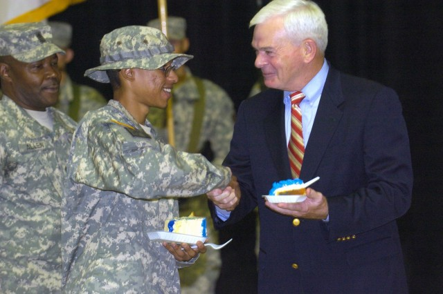 Retired Gen. William F. Kernan, former commander, XVIII Airborne Corps, shakes the hand of Spc. Eric-Brandon Oce, MNC-I security and intelligence, following the cutting of the XVIII Airborne Corps' birthday cake at a ceremony Aug. 22 at the Al Faw Palace, Camp Victory, Baghdad.   The Corps turns 64 on Aug. 25, while also celebrated at the ceremony was the 64th anniversary of the first official Army parachute jump - which took place Aug. 16, 1940.