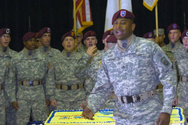 Staff Sgt. Carey Brown, a member of the 82nd Airborne Division's All-American Chorus, sings 'Carolina on my Mind' in tribute to the home of the XVIII Airborne Corps.  The Chorus took part in a ceremony Aug. 22 at the Al Faw Palace, Camp Victory, Baghdad, honoring the first parachute jump and the XVIII Airborne Corps' 64th birthday.