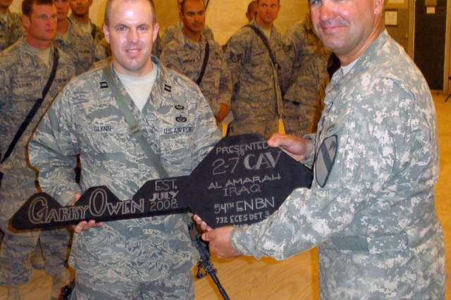 Lt. Col. Edward Bohnemann, commander, 2nd Bn., 7th Cav. Regt., gives the key to the base to U.S. Air Force Capt. Glynn and the 25 Airmen of the 1st Bn., 535th Equipment Support Company Aug. 8.