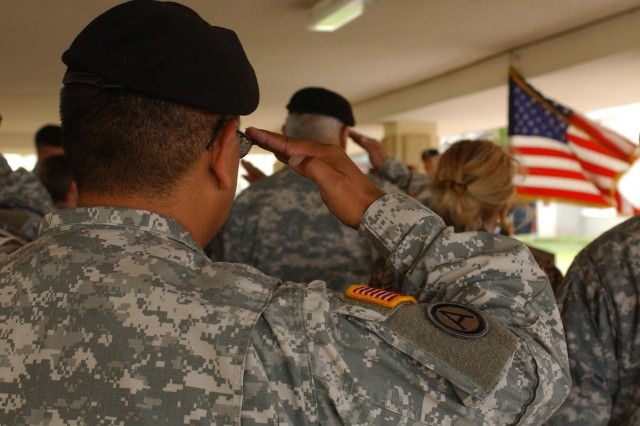 FORT SHAFTER FLATS, Hawaii - Soldiers from the 9th Mission Support Command (MSC) salute the colors during a dedication ceremony, Aug. 18 for Sgt. Evan S. Parker, an Army Reserve Soldier from the 9th MSC killed while deployed to Iraq in 2005.