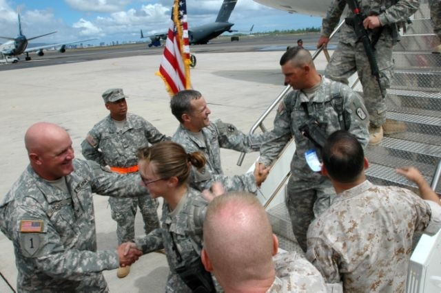 HICKAM AIR FORCE BASE, Hawaii -Members of the 25th Transportation Company are greeted by 8th Theater Sustainment Command Soldiers and Hawaii-based Marines at Hickam Air Force Base, Aug. 14, following a 15-month deployment to the western portion of Iraq.