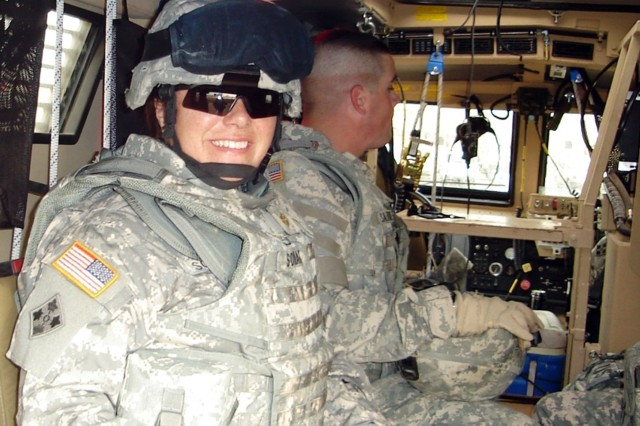 Maj. Ruth Sonak, a native of Humble, Texas, who serves as commander of Company C, Special Troops Battalion, 4th Infantry Division, Multi-National Division - Baghdad, smiles while out on patrol with her Soldiers in Iraq. Sonak is one of many women who serve in various leadership capacities throughout 4th Inf. Div. and MND-B, and throughout the U.S. Army.
