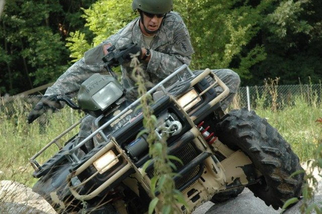 Sgt. Ken Powell, 1/10th Special Forces Group (Airborne), practices maneuvering his quad over a series of rocks while training at the Advanced Mobility Course in Stuttgart, Germany, earlier this month.