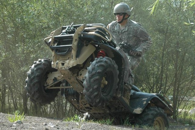 Sgt. 1st Class Jason Dryden, 1/10th Special Forces Group (Airborne), powers his quad runner out of a gully during a training day at the Advanced Mobility Course earlier this month in Stuttgart, Germany. The course, located in Stuttgart's Local Training Area, is the only off-road driver's training site of its kind in the Army.