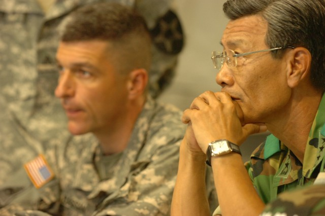 Lt. Gen. Choi, Yong Joo, (foreground) Commanding General of Army Aviation Operations Command, meets with Col. Joseph A. Bassani, (background) Commander of 2nd CAB in the CPOF during UFG Aug. 21.