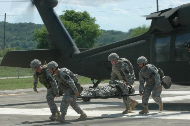 Soldiers transport a simulated casualty from a UH-60 Black Hawk at Story Range June 25. Soldiers assigned to Headquarters and Headquarters Support Company took part in the Division Special Troops Battalion training event aimed at teaching the troops survival skills in the complex urban terrain battlefield.