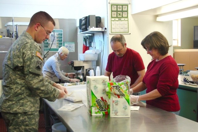 Deployed 5th Signal Soldier donates money, R&R time to the needy
