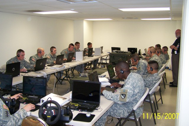 """Soldiers at Fort Hood, Texas, """"play"""" DARWARS in a networked gaming lab. The simulation game provides Soldiers with a series of scenarios, but also affords them the opportunity to modify scenarios and replicate real-life experiences."""