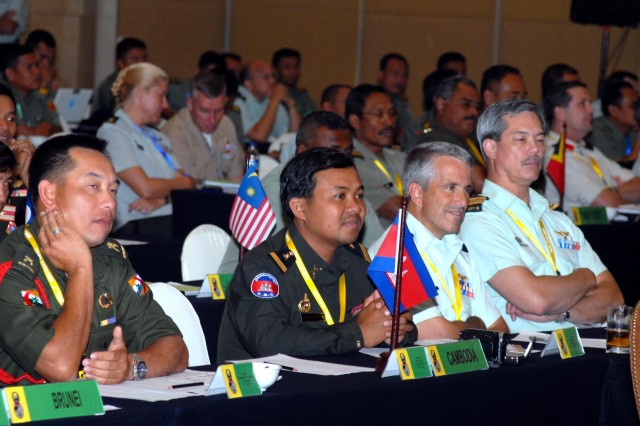"JAKARTA- Senior Army and security officials from 30 nations gathered here for the Pacific Armies Management Seminar (PAMS) XXXII. PAMS is the U.S. Army's largest Asia-Pacific theater security cooperation program event. It is a multinational military seminar that provides a forum for senior-level officers from the Asia Pacific's regional ground forces in U.S. Army, Pacific's area of responsibility to exchange views and ideas. This year's main theme is ""Critical Land/Security Forces' Challenges.""Delegates -- Delegates listen to a briefing by Malaysian Maj. Gen. Martial Dato' Zulkipk bin HJ. Kassim on ""Transitioning from conflict to post-conflict coalition operations"" during Pacific Armies Management Seminar XXXII in Jakarta Aug. 27.  Photo by U.S. Army Sgt. 1st Class Jason Shepherd, United States Army Pacific"