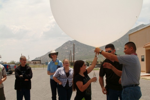 A student in the Army Research Lab's GEMS program launches a weather balloon from the White Sands Missile Range Meteorology Branch. The program is designed to give students a hands-on experience with advanced applications of science, math, and engineering.