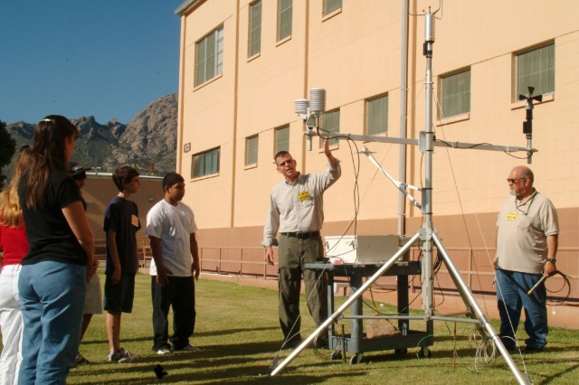 Robert Brice, a meteorology Technician with Army Research Labs, center, explains how ARL can use mobile weather stations to collect weather data for Army testing missions on White Sands Missile Range as part of the Gains in the Education of Mathematics and Science program.