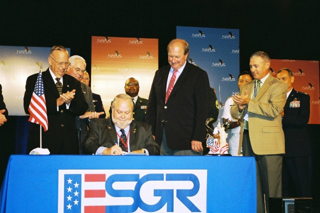 The National Association of Postmasters of the United States (NAPUS) signed a Statement of Support for the National Guard and Reserve Components on August 27, 2008 during their national convention in St. Louis, Missouri.  Pictured are Thomas F. Hall, assistant Secretary of Defense for Reserve Affairs (left), Retired Brig. Gen. Tracy Beckette, chairman - Missouri ESGR Committee, Dale Goff, Jr., president of NAPUS (seated), James Rebholz, Employer Support of the Guard and Reserve (ESGR) national chairman, and Steve Vanderhoof, program support specialist - Missouri ESGR Committee.