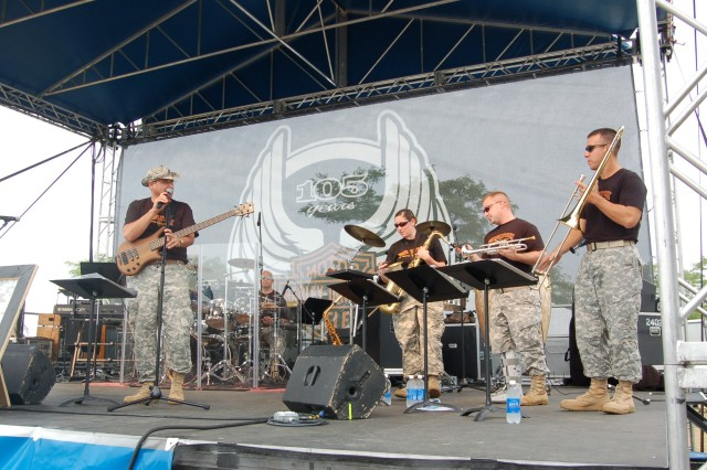 MILWAUKEE -- The 1st Infantry Division Rock Band from Fort Riley, Kan., was the opening act for the Harley-Davidson 105th anniversary celebration Aug. 28. During World War I, almost half of all Harley-Davidson motorcycles produced were sold for use by the U.S. military. At war's end, it is estimated that the Army used some 20,000 motorcycles in their efforts, most of which were Harley-Davidson. When World War II ended, Harley-Davidson had produced almost 90,000 WLA models for military use. (Photo by Jorge Gomez)