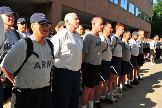 Soldiers and Airmen representing Colorado, Georgia and Nebraska National Guard stand in formation in Devnver to hear their assignments for the day Aug. 27.