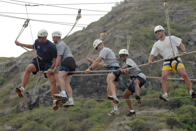 Team Molokai Kanunu crosses single file across the difficult Odyssey III High Challenge Course at YMCA Camp H.R. Erdman, Mokuleia Aug. 30. Team Molokai Kanunu is represented by Brig. Gen. Robert B. Brown, deputy commanding general, 25th Infantry Division.