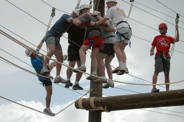 Team Kauai Lalama trek together across the high rope of the Odyssey III High Challenge Course at YMCA Camp H.R. Erdman, Mokuleia Aug. 30. Team Kauai Lalama is represented by Col. Thomas P. Guthrie, chief of staff, 25th Infantry Division.