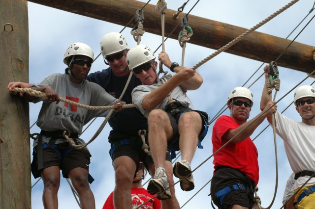 Team Molokai Kanunu begins the difficult Odyssey III High Challenge Course at YMCA Camp H.R. Erdman, Mokuleia Aug. 30. Team Molokai Kanunu is represented by Brig. Gen. Robert B. Brown, deputy commanding general, 25th Infantry Division.