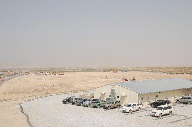 "In this Aug. 15, 2008 view looking from west to east, the ""Eastern Expansion"" of the Army Materiel Command area at Bagram Airfield Afghanistan can be seen. The 401st Army Field Support Brigade (Forward) headquarters building is in the foreground. The work in the distant middle right of the photo is site preparation for an electronics facility, which is one of the first structures scheduled to be completed as part of the expansion."
