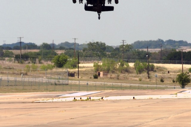 """Although the AH-64D Apache helicopter's engines are loud as it comes in to land, onlookers could almost hear the glee and excitement coming from the Soldier sitting in the front seat. In this rare event, troopers of the 1st """"Attack"""" Battalion, 227th Aviation Regiment, 1st Air Cavalry Brigade, 1st Cavalry Division, had the chance to take a ride in the front seat of an Apache at Robert Gray Army Air Field, Fort Hood, Texas, Aug. 26."""