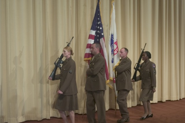 "A color guard from the National Training Center and Fort Irwin posts the National and US Army colors at the beginning of the ceremony at the Academy of Motion Picture Arts and Sciences' Pickford Center for Motion Picture Study. The ceremony was held to return Oscar statutte # 827 to the Army. Statuette #827 is a duplicate of the Oscar presented for ""Prelude to War"" the first of seven pictures in the series ""Why We Fight"" produced by the US Army during World War II. The Soldiers are dressed in authentic World War II uniforms provided by the 11th Armored Cavalry and Fort Irwin Museum."