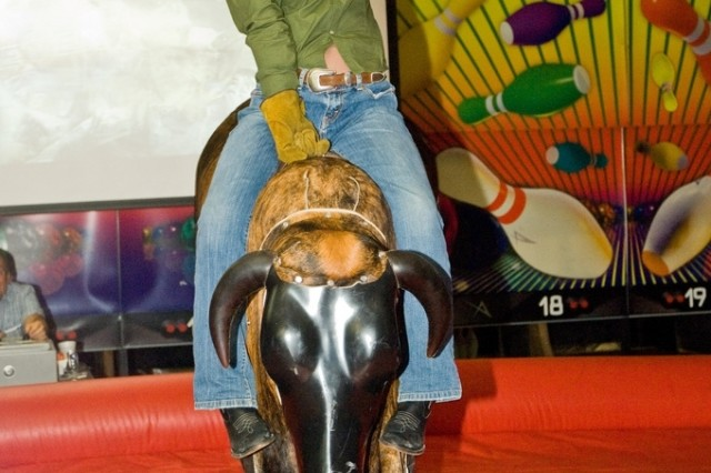 Yongsan community member Angela Bean tries her turn at the mechanical bull during the Yongsan Lanes  Country Night, the finale National Bowling Week events at the bowling center.