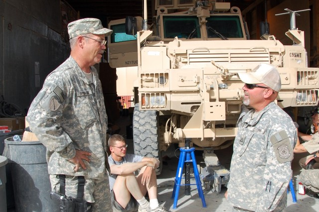 U.S. Army Communication-Electronics Command Logistics Assistance Representative Brian Cafferty (right), discusses BLST capabilities with Master Sgt. Mark Spurlock, battalion maintenance supervisor, 201st Engineer Battalion (Kentucky National Guard), at FOB Sharana, Afghanistan, Aug. 16, 2008