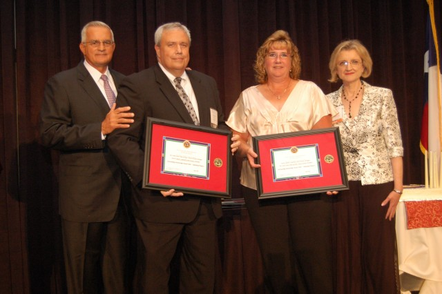Retired Gen. Thomas Schwartz, Dr. Charles Muncatchy, superintendent of Mt. Clemens Community Schools, Wendy May, school liaison officer for U.S. Army Garrison-Detroit Arsenal, and Dr. Mary Keller, executive director of the Military Child Education Coalition, display awards at the Pete Taylor awards ceremony.