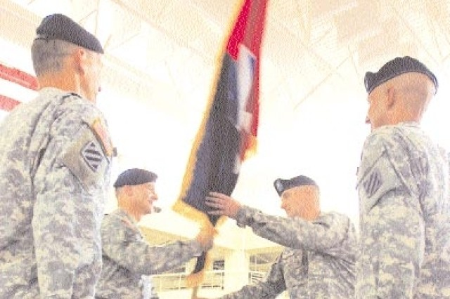 Maj. Gen. Tony Cucolo (left), commander of the 3rd Infantry Division, passes the  Combat Aviation Brigade guidon to incoming CAB commander, Col. Donald Galli during a change of command ceremony, Aug. 28 at Hunter Army Airfield.