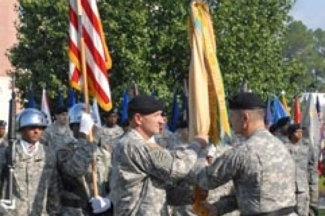 3rd Sustainment Brigade welcomes new commander - Maj. Gen. Tony Cucolo, 3rd Infantry Division commanding general, passes the 3rd Sustainment Brigade colors to Col. Shawn Morrissey, 3rd SB incoming commander, at a change of command ceremony held at Marne Garden, Aug. 27.
