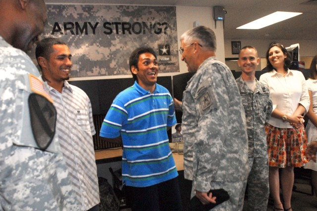 PEARL CITY, Hawaii - Gen. George Casey, Chief of Staff of the Army, jokes with Anthony Amadeo, a new Army recruit, while visiting the U.S. Army Recruiting Station, Pearlridge, Hawaii. Amadeo enlisted together with his brother Kalani Amadeo (left) and both will go to basic training the week of September 11th.