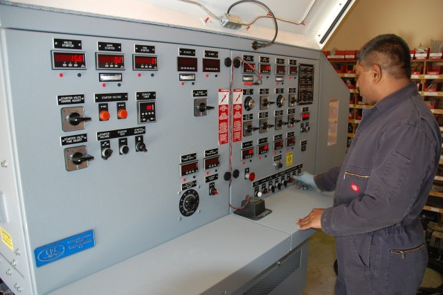 Senior electrician Viswasankar Thambi, a contract employee from Kanyakumari, India, checks the control panel on a new 400-ampere generator test stand as he and other technicians ready it for use at the 3rd Battalion, 401st Army Field Support Brigade's Fuel and Electric Shop, Aug. 20, at Bagram Airfield, Afghanistan.  The new stand will allow testing of automotive alternators, generators, regulators and starters under full electrical load, ensuring they will hold up under combat conditions when installed in Mine Resistant Ambush Protected vehicles, Humvees and other vehicles being used by warfighters in Operation Enduring Freedom.