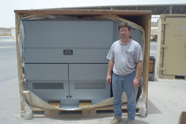 ITT Corp. employee, Curtis Knott, posed by the generator test stand he prepared for shipment from 1st Battalion, 401st Army Field Support Brigade in Qatar, to the brigade's 3rd Battalion in Afghanistan.