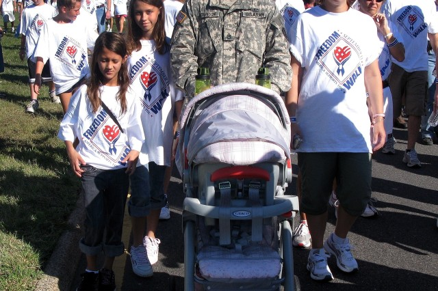 Staff Sgt. Chad Atkinson walked with his family in the fourth annual America Supports You Freedom Walk near the Pentagon, Sept. 7.