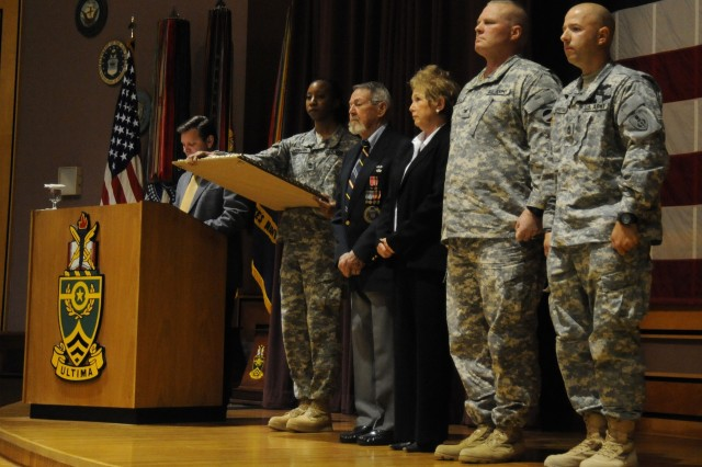 Master Sgt. Eric Geressy (far right) stands at attention while the narrator reads the citation to accompany the award of the Silver Medal. With Geressy are (l-r) his grandfather, World War II veteran Mitchell Rech, his mother Mary Ann Geressy and Col. Michael Steel, Deputy G3 Training, U.S. Army Forces Command and Geressy's former brigade commander with the 101st Airborne Division. Gereesy was awarded the medal during ceremonies held Sept. 5 at the U.S. Army Sergeants Major Academy, Fort Bliss, Texas, where Geressy is a member of Class 59.