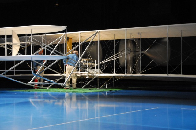 A replica of the Wright Model A aircraft was on display Sept. 6 at Conmy Hall, Fort Myer, Va., as part of the centennial of military aviation celebration there.  During the opening ceremony of the celebration, builders of the aircraft spun the propellers to start its engine. The plane's single engine spun its wooden propellers and filled the hall with a sound not heard on the installation for 100 years.