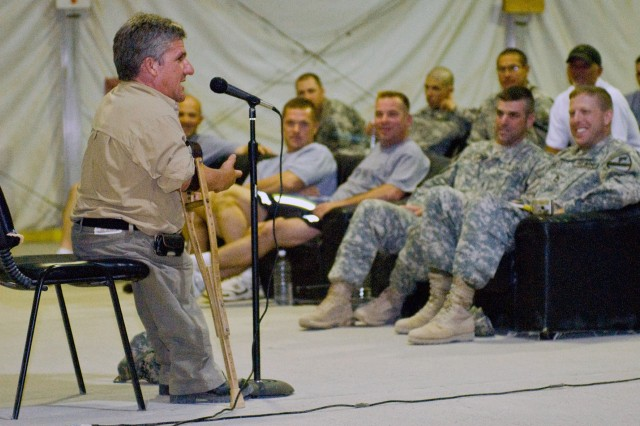 "Matt Roloff, star of The Learning Channel's show ""Little People, Big World"" talks with Soldiers at Contingency Operating Base Adder Sep 6.  Roloff and his family have a condition called dwarfism and the show portrays how they live with"