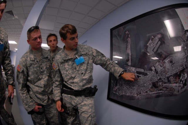 Florida National Guard Special Forces review city maps for recon missions in Key West, Fla., in preparation for Hurricane Ike, Sept. 8.