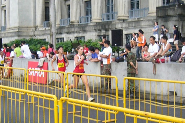 Army 1st Lt. Kelly Calway, with the 500th Military Intelligence Brigade, come to the finishline of the 17th Annual Singapore Army Half Marathon, August 24. This was the first time the U.S. Army competed in 13.1 mile race, and Calway was the first female in the event's history to represent a foreign army.