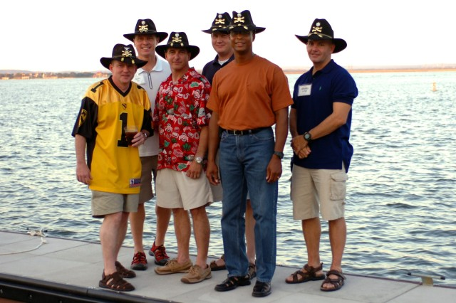 "Senior leaders of the 1st Air Cavalry ""Warrior"" Brigade, 1st Cavalry Division, pause for a photo along side the shores of Lake LBJ at the Horseshoe Bay Resort Marriott, Marble Falls, Texas. The staff and their families enjoyed the relaxing surroundings of the lake in between classes focused towards team building. From left to right: Col. Douglas Gabram, commander of the 1st ACB; Lt. Col. Dean Keck, commander of 615th Aviation Support Battalion, 1st ACB; Lt. Col. Ralph Litscher, commander of 2nd Bn., 227th Aviation Regiment, 1st ACB; Lt. Col. Randall Haws, commander of 4th Bn., 227th Avn. Regt.; Lt. Col. Charles Dalcourt, commander of 1st Bn., 227th Avn. Regt.; and Lt. Col. Jeffrey Metzger, commander of 3rd Bn., 227th Avn. Regt."