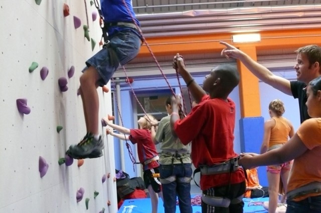 A young climber tries his hand on the rock wall during the Villaggio Youth Services Center grand opening Sept. 5 at U.S. Army Garrison Vicenza, Italy.