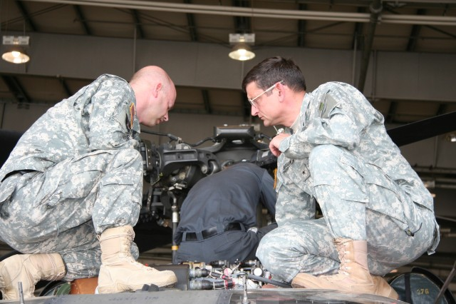Brig. Gen. Mark Bellini (right), U.S. Army Europe G-4, visited the TASM-E during pre-deployment maintenance for KFOR 10 to receive a briefing on the unit\'s aviation readiness.