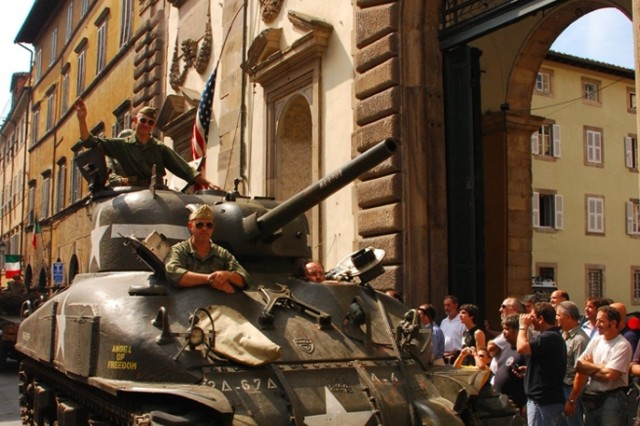 A World War II-era Sherman tank rolls into historic downtown Lucca, Italy, during a re-enactment ceremony that included Soldiers assigned to U.S. Army Garrison Livorno, Italy.