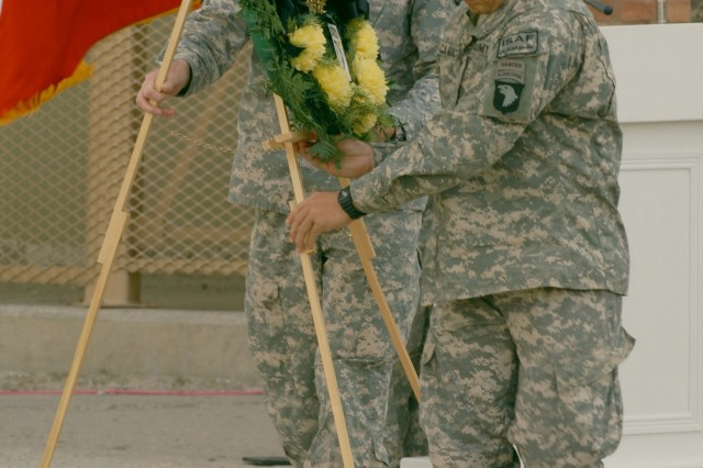 BAGRAM AIR FIELD (Sept. 11, 2008) -- During the 9/11 ceremony held on Bagram Air Field Maj. Gen. Jeffrey Schloesser, Commanding General of Combined Joint Task Force-101, along with Command Sgt. Maj. Vincent Camacho, Command Sgt. Maj. of CJTF-101 set a reef in place in memory of those who were killed seven years ago Thursday. . (U.S. Army photo by Spc. Scott Davis)