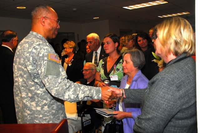 Lt. Gen. Michael D. Rochelle, the deputy chief of staff G-1, spoke with some of the dozens of Soldiers, Army civilians and family members who had gathered to attend a memorial ceremony for G-1 and Manpower and Reserve Affairs employees who died during the Sept. 11, 2001 terrorist attacks on the Pentagon.