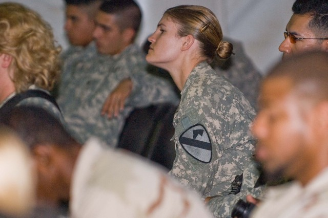 First Lieutenant Joanne Cotton, a military intelligence officer assigned to the Long Knife Brigade's 27th Brigade Support Battalion, focuses her attention during guest speaker Lt. Col. Tim Norton's speech during COB Adder's Sept. 11