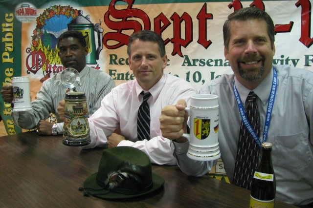 Staff members of Family Morale Welfare and Recreation toast a weekend of fun as Oktoberfest prepares to open its gates tomorrow at the Arsenal's parade field. From left are, Kenneth McDonald, FMWR resource management chief; FMWR director Derrick Gould; and Mark Germonprez, chief or the FMWR Business Division.