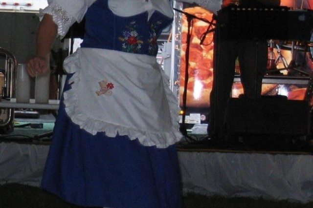 Dressed in traditional German fashion, an employee of the Officers and Civilians Club takes time out from her waitressing duties during Oktoberfest 2007 to dance to the music of Terry Cavanaugh and the Alpine Express.