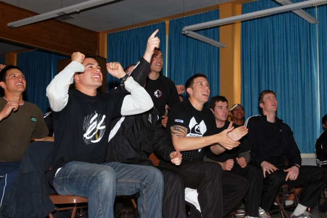New Zealand Rugby fans cheer as their team pushes ahead of Australia during the Australian Wallabies and New Zealand All Blacks rugby match Saturday at the Community Activities Center in Hohenfels, Germany.  The fans are Soldiers participating in Cooperative Spirit 2008 at the Joint Multinational Readiness Center.